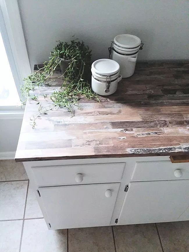 Make A Faux Wood Countertop With Peel And Stick Wallpaper Stow Tellu Wood Countertops Countertop Makeover Wood Countertops Kitchen
