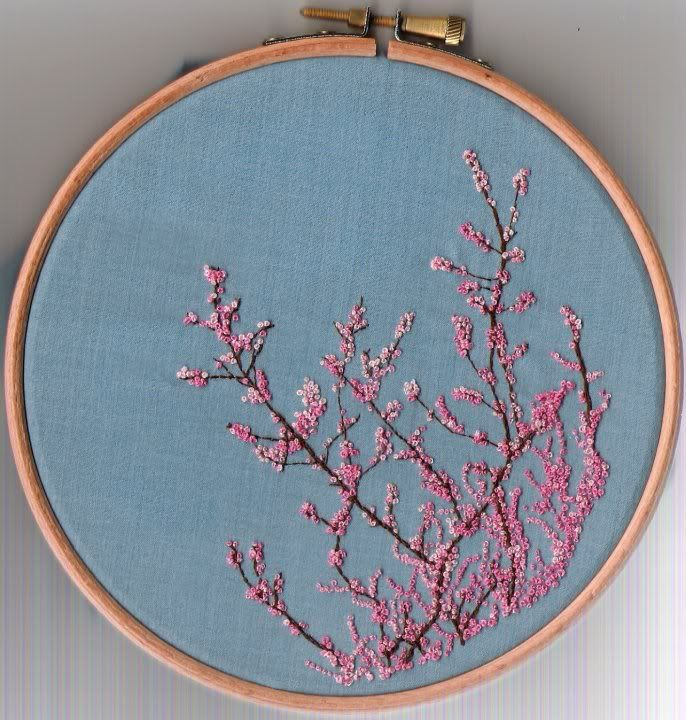 I used 2 different pinks, a light and a dark. And I also stripped down the thread and used 1 strand of each so that some of the french knots are an inbetween mix of the 2 colours. The brown branches are just back stitch.  Embroidery hoop byFair Rosamund  So pretty!