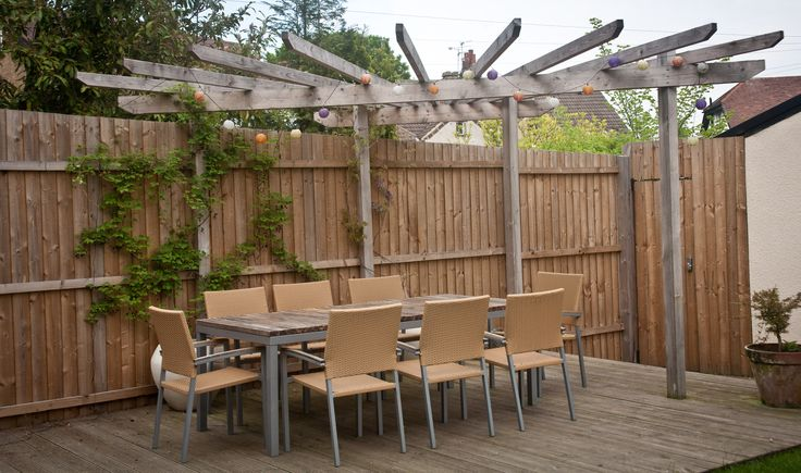 Decking with pergola over.  Akebia and Wisteria climbing up the structure