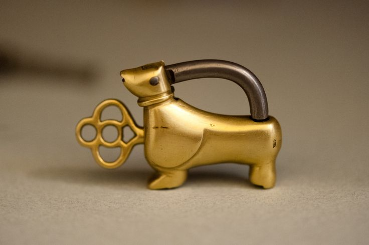 An old lock and key in the shape of a dog (dachshund?).  Made in Iran.