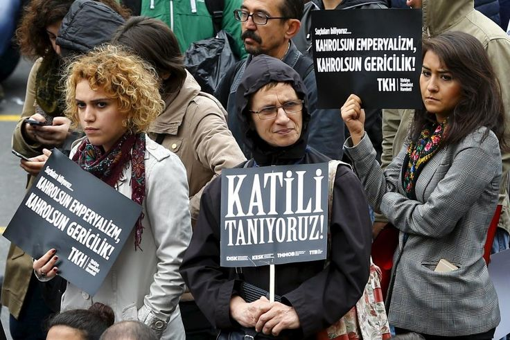 "Demonstrators hold placards read that: ""We know the murderer!"" (C) and ""Damn to imperialism, Damn to reactionism"" (L and R) during a protest against Saturday's Ankara bombings, in Istanbul, Turkey, October 13, 2015. Turkey's government said on Monday Islamic State was the prime suspect in suicide bombings that killed at least 97 people in Ankara, but opponents vented anger at President Tayyip Erdogan at funerals, universities and courthouses. REUTERS/Murad Sezer"