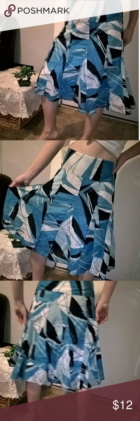 apt.9  bold blue print skirt Pleated blue white and black skirt 100% cotton. Tight around the waist and flares out. Zips up the side and has a white inside thin lining. I am a size 4 and this skirt is tight on me bull Apt.9 Skirts Midi