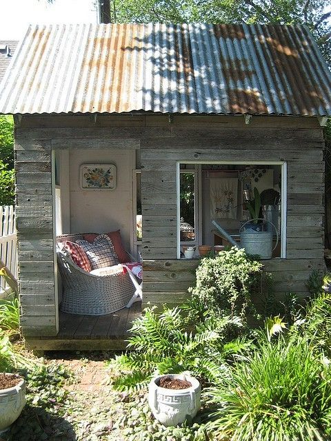 Little she shed with weathered wood and tin roof