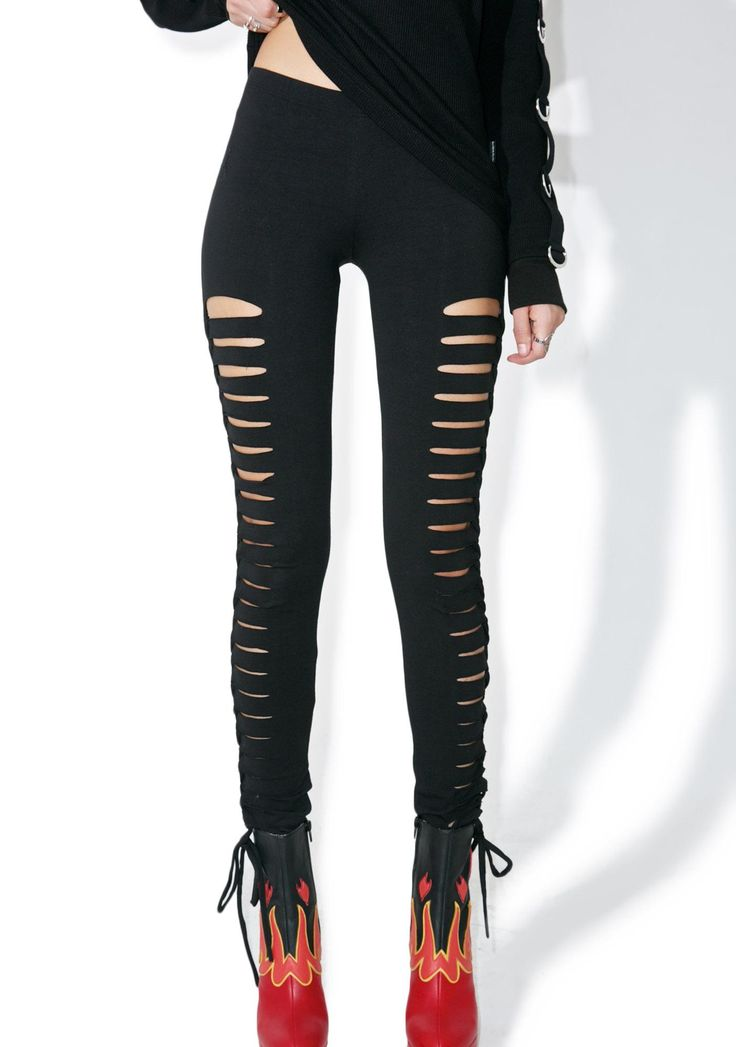 Tripp NYC Side Cut-Out Leggings ...it's alwayz fun to keep a lil somethin' on da side. These sassy leggings are superr comfy with a soft stretch material perfectly huggin' yer curves, featurin' open cut-outs running down yer legz complete with ankle ties.