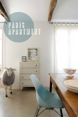 Great modern blue chair paired with a rustic farm table.