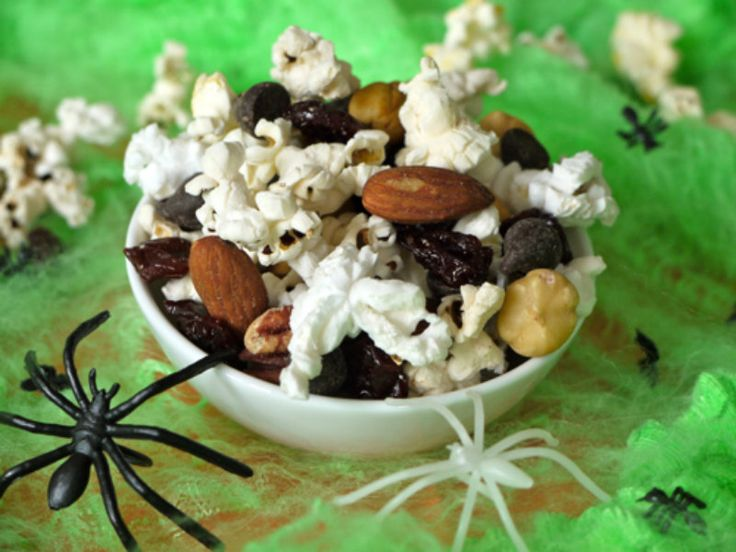 Want something crunchy munchy and mostly healthy to fill the kids up before a night of trick or treating Let the kids get involved making Popcorn Trail Mix and watch it quickly