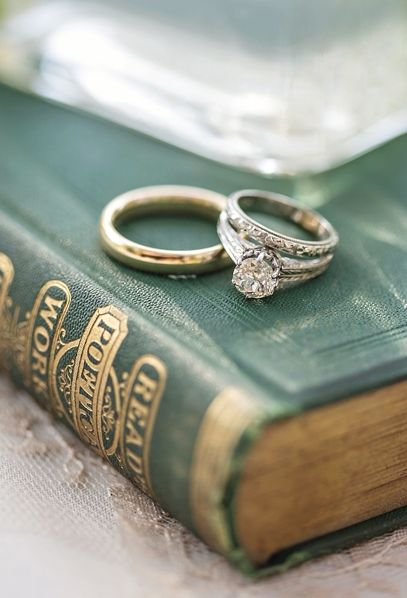 Forest Green Vintage Books and Engagement Rings | Paper Lily Photography | See More! http://heyweddinglady.com/down-the-garden-path-a-forest-green-and-peach-wedding/