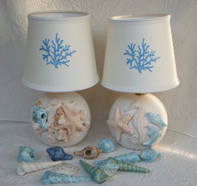 A pair of bedside lamps from the Capri line. The colour and exuberance of the sea expressed in the imagery on the lamp and the shade. A coral motif is embrioded into the shade. £280