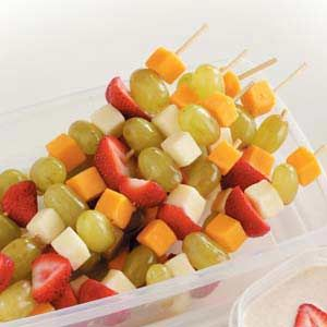 Fruit and Cheese Kabobs Recipe -Our Test Kitchen staff, many of whom are busy young mothers themselves, came up with this fresh and fruity, summer snack idea. It's easy to make ahead and carry to the ballpark, beach or playing field, and the cinnamon-spiced yogurt dip adds that special touch kids love.