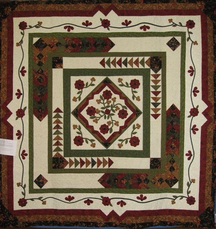 Viewer's Choice 3rd Place to Heather Bennett. Quilt Name:  Round Robin Quilt (Mortgage Quilt)  Made By: Heather Bennet, Bev Rose, Esther Lewis & Barbara Hamilton  Quilted By:  Robyn McHardie Sunshine Quilts. Designed by 4 of the group.