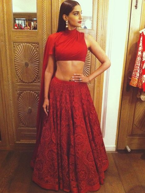 Sonam Kapoor in Shantanu & Nikhil. This ultra-modern understated crimson coloured bridal piece by the designer duo is perfect for the modern Indian bride. Minimal jewellery, slick hair, high neck blouse all add to this understated chic bridal look. Love it! Indian designer - Indian couture - Indian bride - Indian wedding #thecrimsonbride