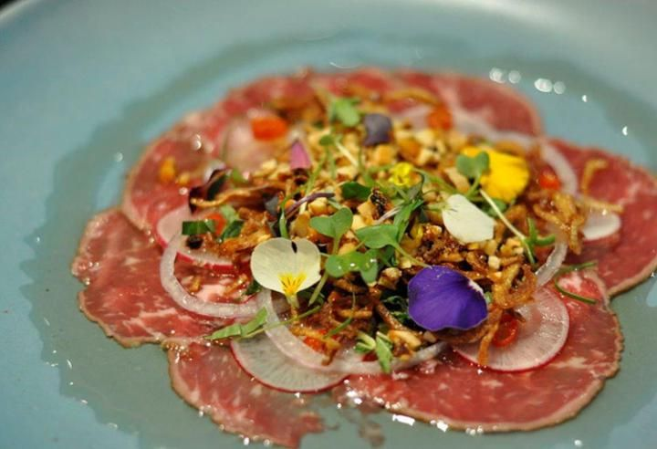 "Shot of Heritage Angus Beef Carpaccio at Raw Bar by Duncan Ly (Photo by Curt Woodhall). Raw Bar by Duncan Ly & Chef's Table at Kensington Riverside Inn are two restaurants in the Hotel Arts Group that are profiled in ""Shining Culinary Stars: A Guide To Calgary's Dining Scene"" by Mhairri Woodhall, published in BC Living in April 2014."
