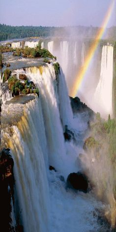 Rainbow over Iguazu Falls, Brazil #Waterfalls #BeautifulNature #NaturePhotography #Nature #Photography #Travel #Brazil