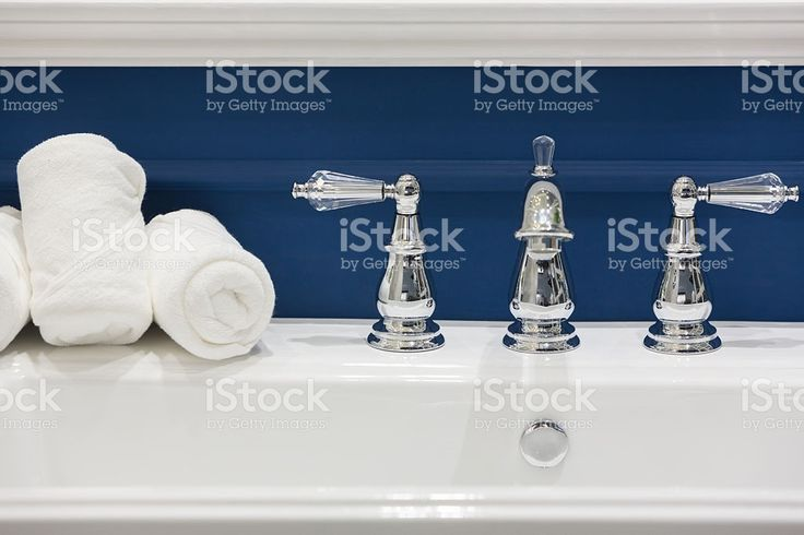 Three white hand towels on a white basin royalty-free stock photo
