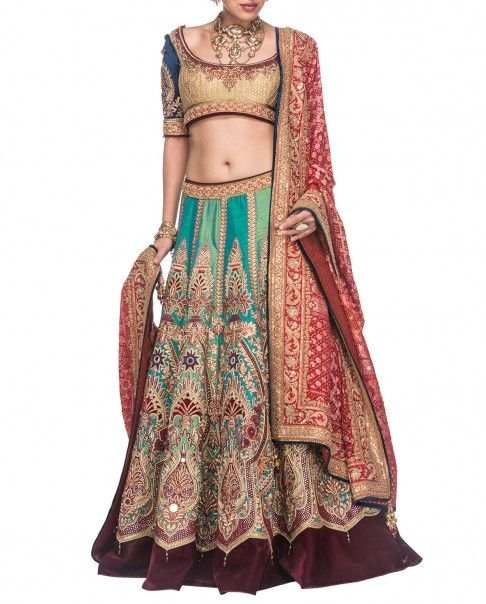 This Bridallehenga is in silkfabric. Skirt of this lehenga is in 2 aqua colours stripes which have muliticolour hand embroidery on it.The lehenga skirt hasw
