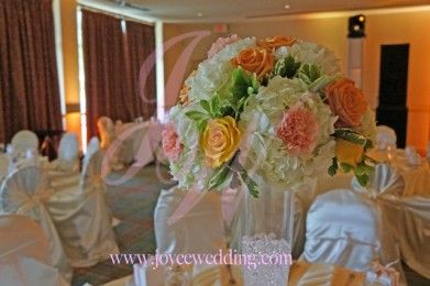 Yellow and orange centerpieces at Station Creek Golf Club wedding