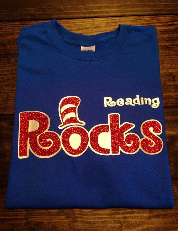 ~~Reading Rocks~~ This shirt is perfect to wear to celebrate Dr. Seuss Day which is also Read Across America Day. This design is done on a regular unisex fit short sleeve t-shirt. The design is done i