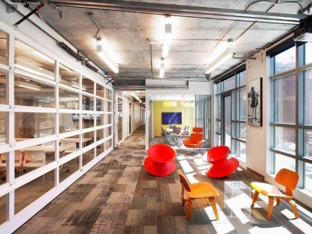 Collaboration space and meeting room with garage door for Garage man door
