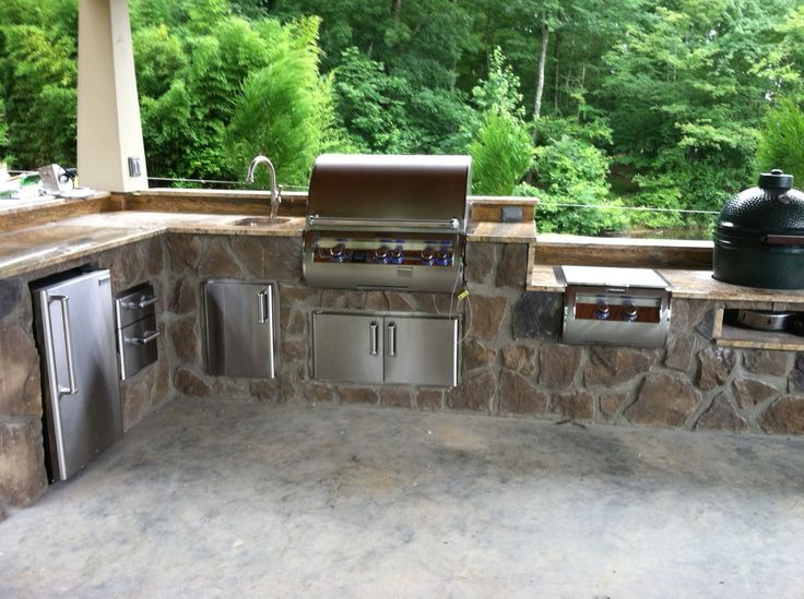 this is a custom outdoor kitchen with a built in