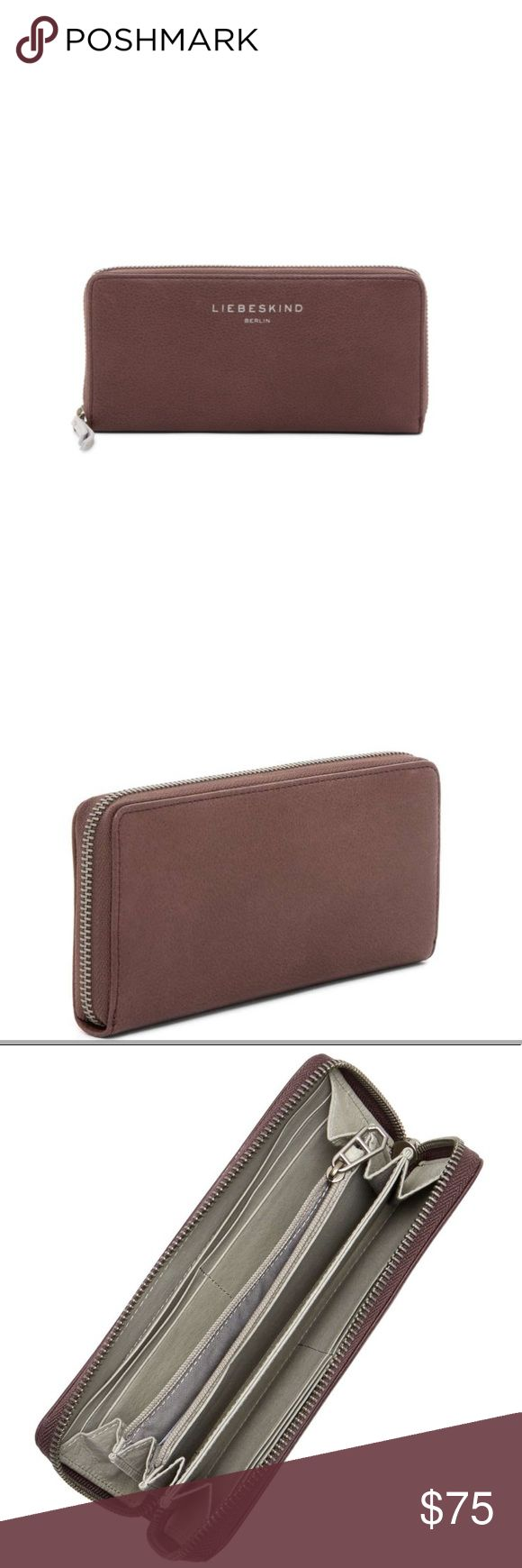 Liebeskind Sally Zip Around Leather Wallet Zip-around closure. Interior features 8 card slots, 2 currency pockets, 1 center zip pocket, and 3 open compartments. Approx. Leather exterior and lining.. Color: Plum Liebeskind Bags Wallets