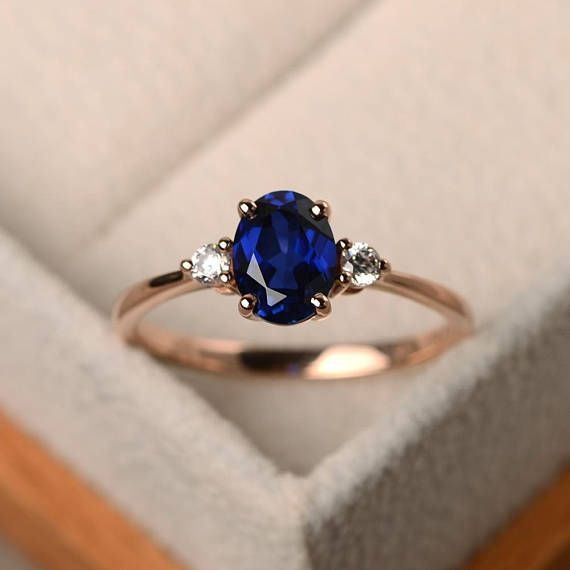 This ring features a 6*8mm oval cut lab sapphire and sterling silver finished wi…