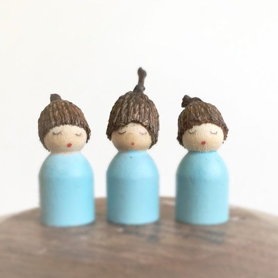 Three little baby peg dolls with attached acorn caps. A lovely addition to a nature table and doll house, open ended sensory play. Available in any color of the rainbow, please allow 3 days for custom orders. Acorn babies measure 1/2 inch and are painted with nontoxic watercolor paint and finished with my organic coconut oil/beeswax polish. Peg doll is small enough to be a choking hazard and is not intended for children under three, children who are still putting toys in their mouth. For…