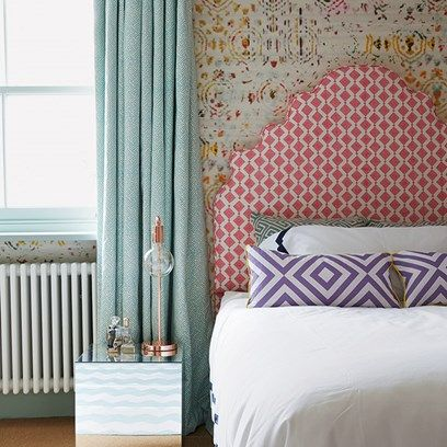 In this children's bedroom by Henri Fitzwilliam-Lay, a fixed and shaped box pelmet with curtains in a pale blue fabric is a smart choice in both senses of the word; it will not be quickly outgrown as children become teenagers and it looks modern and elegant.