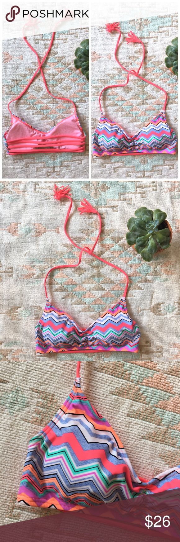 Strappy Chevron Bikini Top, Tropical Swim Suit Cute bikini top! Strappy back. Halter straps that tie around the neck. Women's Large. Padding (not push-up) in each cup. Colorful chevron pattern! Pink, blue, black, white, orange, purple, aqua. Straps are bright pink. Like new condition! Swim Bikinis