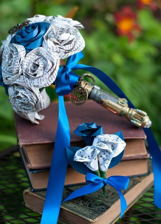 My Doctor Who / Lord of the Rings bridal bouquet! The book pages are from the LOTR book, the sonic screwdriver is River Song's. The Groom's boutonniere has sheet music (he's into production & DJing) 'I Remember' by Deadmau5 & Kaskade  By Diddlebug on Etsy here: https://www.etsy.com/shop/DiddleBug  #BridalBouquet #WeddingTheme #DoctorWho #LOTR