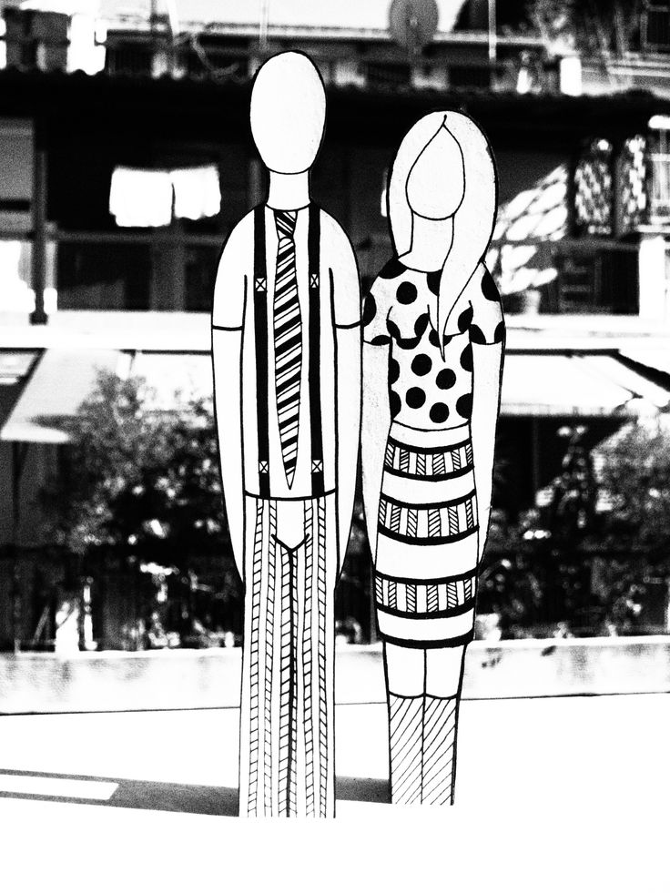 black and white wood figurines with print stripes and dots