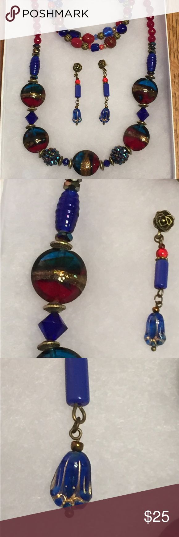 Big Lamp Work Glass Necklace Earrings and Bracelet Dark red and cobalt blue swirled with gold glitter big fat pillowy lamp worked beads like the ones in this necklace are works of art in their own right!  Add a variety of other glass beads and bronze accents and it becomes pretty easy to make something awesomely beautiful!   Great price.  These beads are costly but worth it.  Yours today for a steal with double-strand bracelet and Cobalt Blue Pressed Czech Glass Matching Earrings!  All…