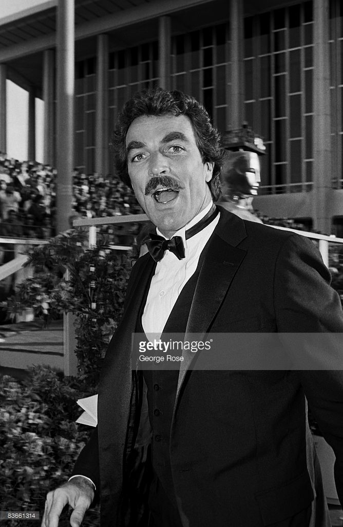 Emmy Award-winning actor, Tom Selleck, poses on the red carpet during the 1983 Los Angeles, California, Academy Awards presentation. Selleck starred in the hit TV show 'Magnum P.I.'
