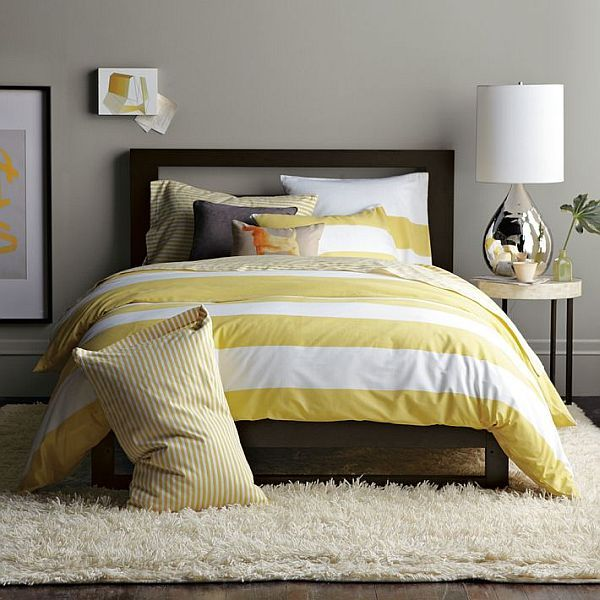 Beautiful Yellow Grey Bedroom Design With Yellow Striped Duvet And White Rug Areas