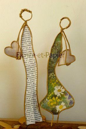 Figurines en ficelle de kraft armé et papiers originaux A l'aube du printemps, deux amoureux ... Entendez-vous le coeur de chacun ? Deux coeurs qui battent à l'unisson .. - 20035663