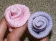 2 baby sock roses