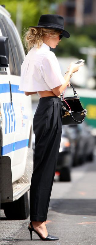 How To Style A Black And White Outfit: Mary is wearing a white Alexander Wang crop top with Alexander McQueen trousers