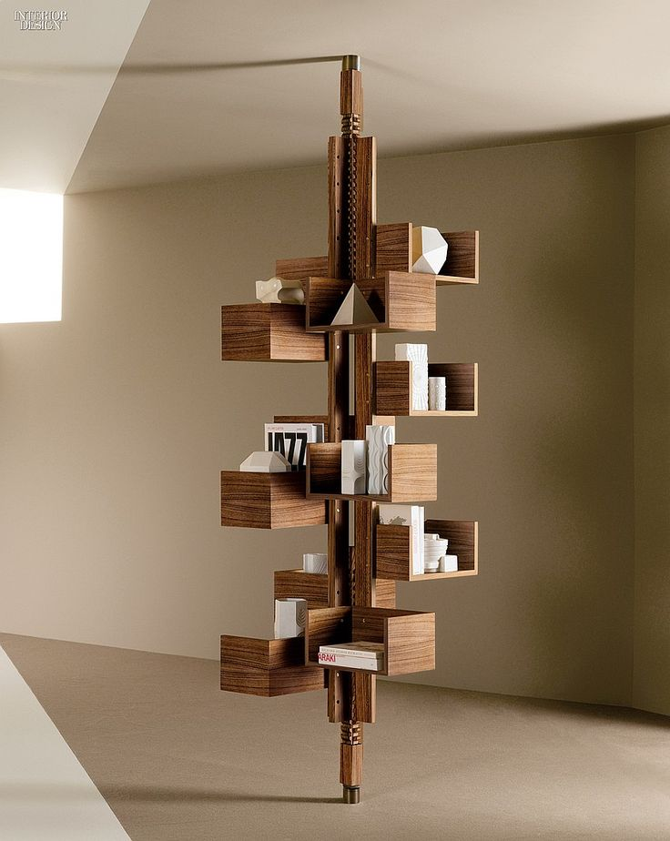 Albero by Gianfranco Frattini for Poltrona Frau. Designed by Gio Ponti's apprentice in the 1950's, the walnut-veneer MDF bookcase is rotating, adjustable, and self-supporting.