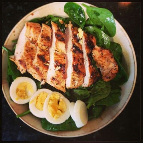 Marinated roasted chicken served over spinach with a citrus vinaigrette (GP: this looks like a fabulous play on spinach salad! Trim the spinach thoroughly.)