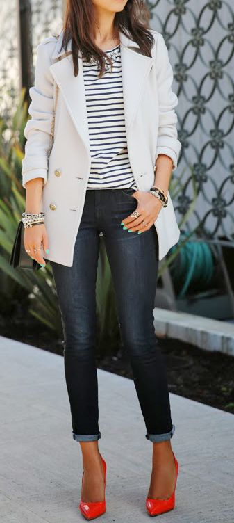 Dark skinny jeans rolled up, striped top, white or cream pea coat, bright pumps, and silver jewelry.