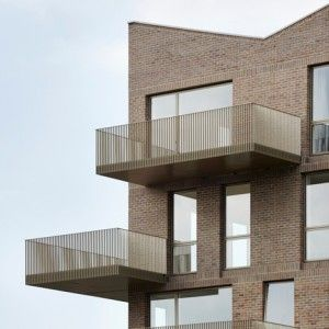 Duggan+Morris+uses+simple+brickwork+and++golden+steel+for+canalside+housing