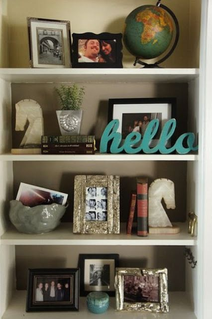 This blog site has numerous examples of bookshelves arrangements using different styles.