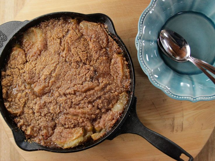 Skillet Apple Crisp : Unlike pie, which requires the careful rolling of dough, crisps and crumbles are fuss-free. Ree simply creates a flour-butter mixture with sugar and fragrant spices, then sprinkles it atop a skillet full of sweetened apple slices.