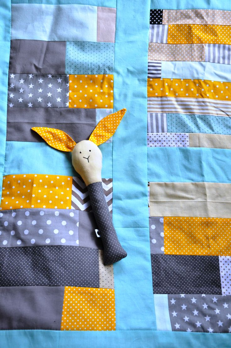 Baby quilt with a sweet bunny toy