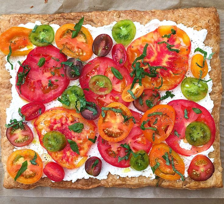 Puff pastry, ricotta, and heirloom tomatoes: We don't know whether to eat this or frame it. Get the recipe here.    - Delish.com