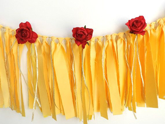 Make your princesss special day a royal one with a beautiful Beauty and the Beast inspired birthday banner. The perfect party decoration to make your party an elegant one with yellow fabric, satin and gold ribbon and red roses with red glitter. Materials: Yellow fabric strips Yellow satin ribbon Gold ribbon Jute String Red foam roses Red glitter Made to order in smoke and pet free studio Measures 3.5 ft long Strips are 10 inches long Roses are approximately 2.5 inches W 2.5 ft of excess…