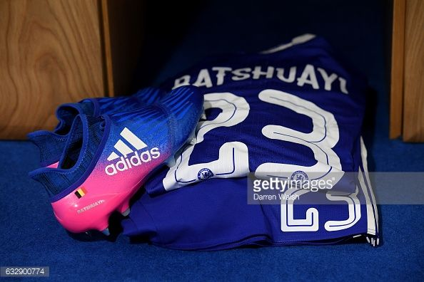 News Photo : The shirt and boots worn by Michy Batshuayi of...