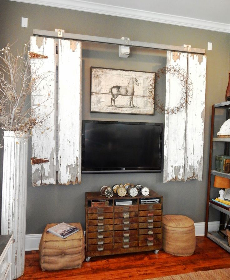 My Romantic Prairie Home - sliding barn-style doors hide TV