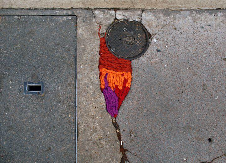 street art by Juliana Santacruz Herrera http://restreet.altervista.org/juliana-santacruz-herrera-restaura-le-strade-con-i-fili-colorati/