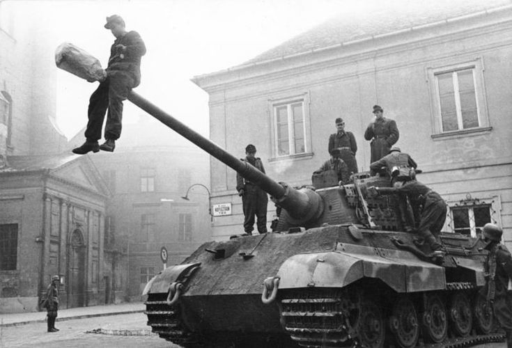 One of the heaviest WW2 tanks ever created, the Tiger II. It weighed ~68.5 tones and had 100-180mm armour on the front. Budapest, Hungary, 1944.