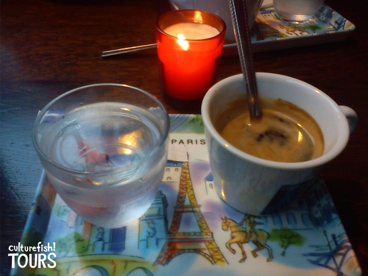 Enjoying a café in Paris. www.culturefishtours.com